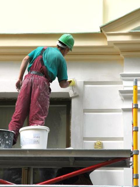 painter exterior house scaffolding Winter Park
